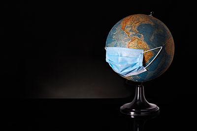 Globus mit Mundschutz